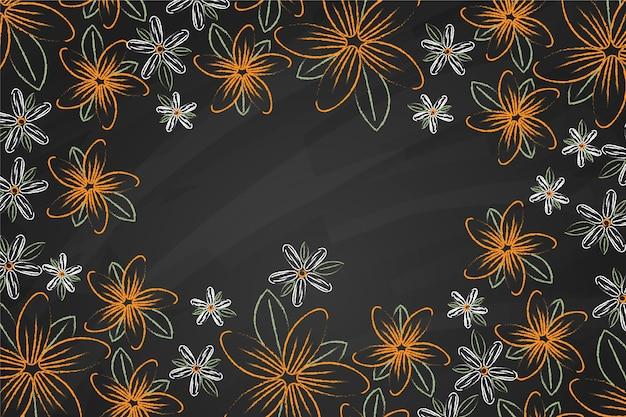 Flores douradas sobre fundo de quadro-negro