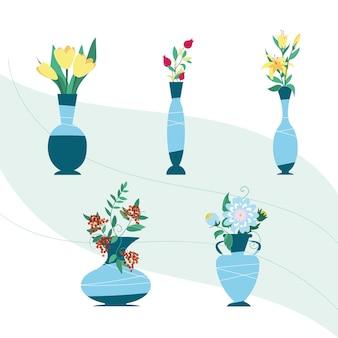 Flores em vasos, um conjunto. diferentes flores em vasos de cor azul de diferentes formas