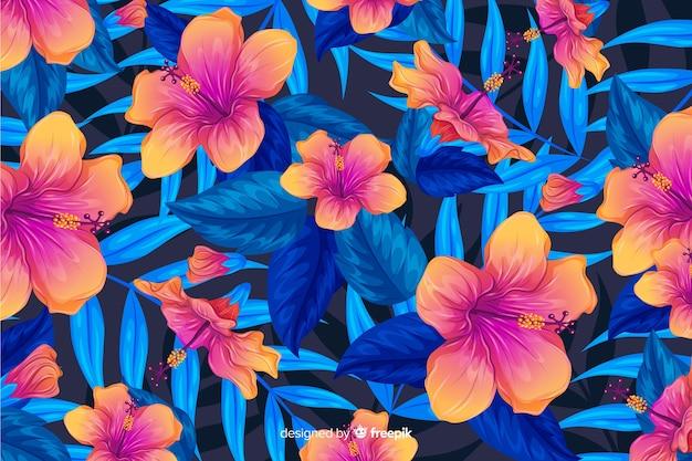 Flores tropicais coloridas e fundo de folhas