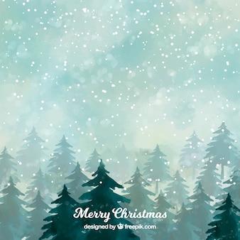 Floresta nevada em uma noite de natal
