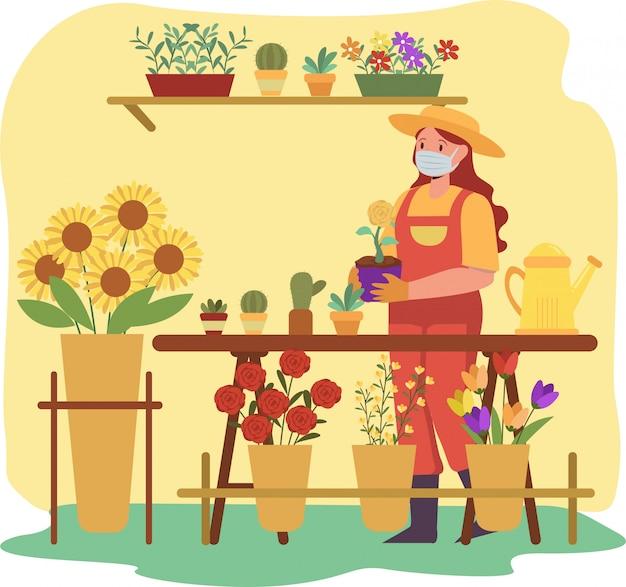 Florista está cuidando das flores enquanto continua usando máscara médica