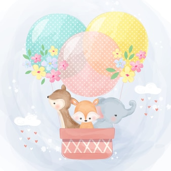 Fofo elefante, rena e raposa voando com balão de ar