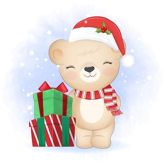 Fofo urso de pelúcia com caixa de presente no inverno e ilustração de natal