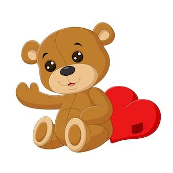 Fofo urso de pelúcia com coração vermelho