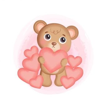 Fofo urso de pelúcia segurando um coração.
