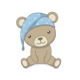 Fofo urso de pelúcia sentado com chapéu de dormir