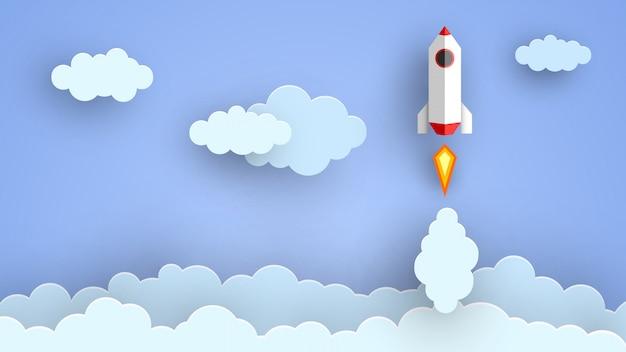 Foguete voando em nuvens de corte de papel.