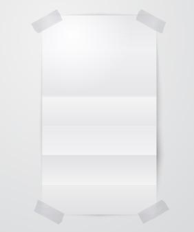 Folha de papel em branco dobrada com fita adesiva