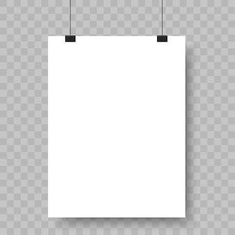 Folha de papel em branco pendurada em fichários.
