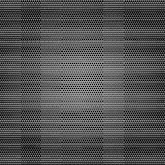 Folha metálica perfurada em fundo cinza escuro