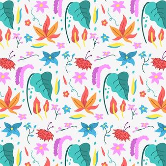 Folhas coloridas e padrão de flores tropicais