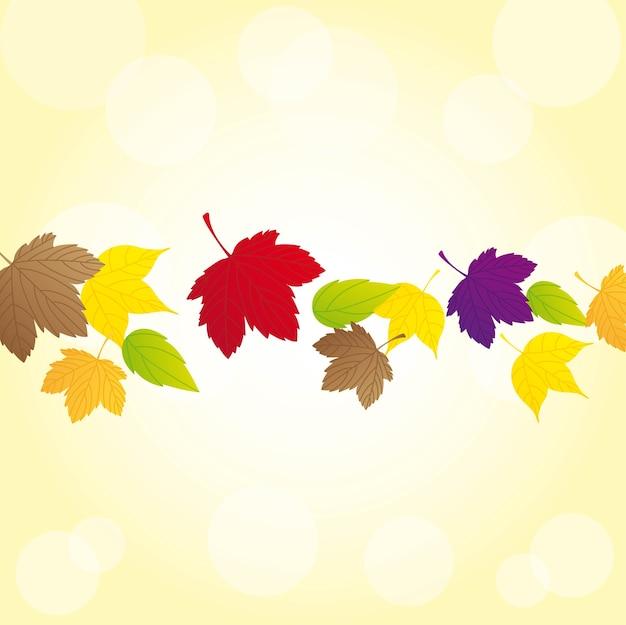 Folhas de outono sobre fundo amarelo