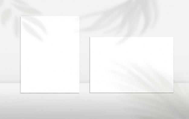 Folhas de papel a4, cartões em branco ou notas com efeito de silhueta de sobreposição de sombra. design minimalista