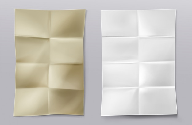 Folhas de papel branco e kraft em branco dobradas
