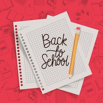 Folhas de papel e lápis de volta à escola