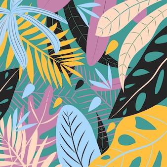 Folhas tropicais coloridas sobre fundo verde