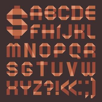 Fonte de fita adesiva acastanhada - alfabeto romano