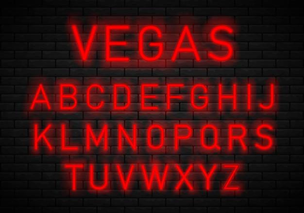 Fonte de néon no fundo da parede de tijolo. alfabeto de fonte.
