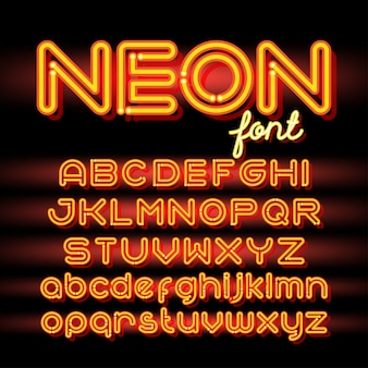 Fonte do alfabeto de luz de néon. letras de tubo de néon em fundo escuro.