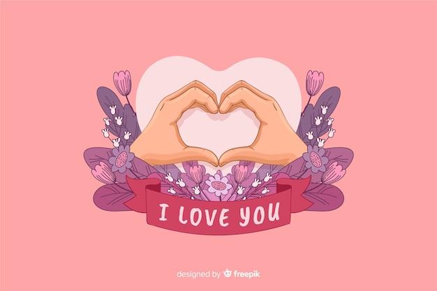 Forma de coração feita com as mãos e eu te amo fita