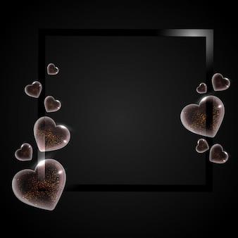 Formas de coração transparente brilhante no fundo preto com espaço fo