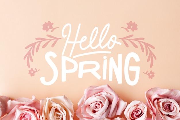 Foto com letras de primavera olá e rosas