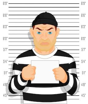 Foto criminal um criminoso preso fica ao lado da parede