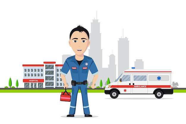 Foto de um paramédico em frente ao carro da ambulância e ao prédio do hospital