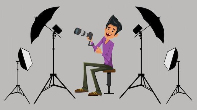 Fotógrafo em seu estúdio com equipamento
