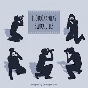 Fotógrafos em diferentes posturas