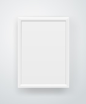 Frame branco quadrado vazio em uma parede.