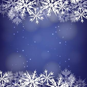 Frame dos flocos de neve em um fundo azul bokeh