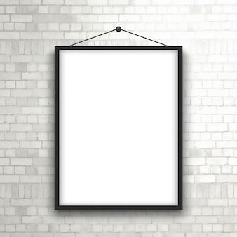 Frame em branco quadro pendurado em uma parede de tijolo