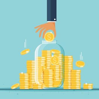 Frasco de dinheiro de vidro cheio de moedas de ouro e mão crescimento, renda, economia, investimento símbolo de riqueza