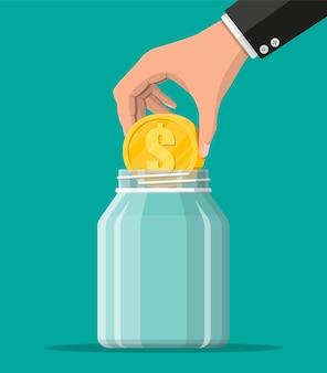 Frasco de dinheiro de vidro com uma grande moeda de ouro. salvar moedas de um dólar no mealheiro. crescimento, renda, poupança