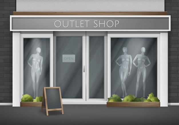 Frente de loja vazia com grandes janelas com manequins