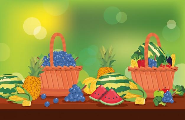 Frutas frescas e legumes na mesa de cesta