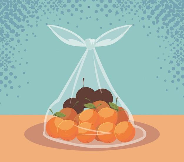 Frutos de laranjas frescas em saco plástico