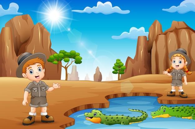Funcionários do zoológico com crocodilos no deserto