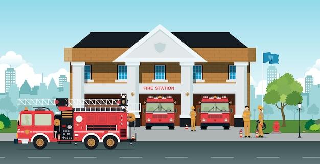 Funcionários e caminhões de bombeiros estão em frente à estação