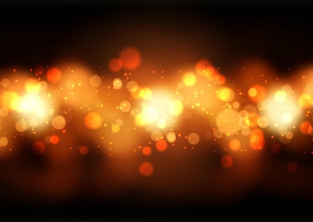 Fundo abstrato com luzes douradas do bokeh