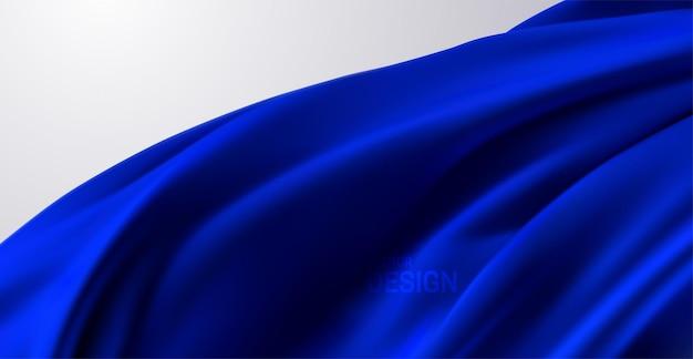 Fundo abstrato com tecido de seda drapeado azul
