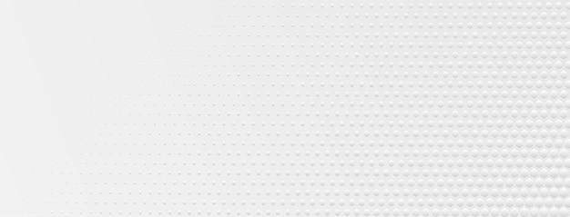 Fundo abstrato de meio-tom feito de pequenos pontos hexagonais de diferentes tamanhos nas cores cinza e branco