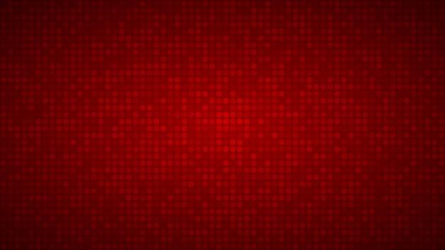 Fundo abstrato de pequenos círculos ou pixels em cores vermelhas.