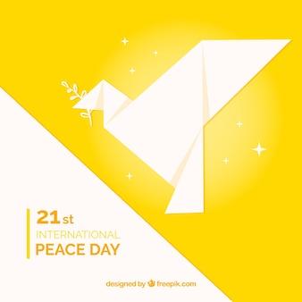 Fundo amarelo do dia da paz com origami pomba
