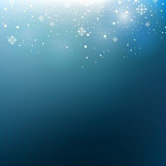 Fundo azul abstrato do inverno. floco de neve e luz