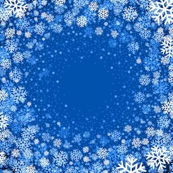 Fundo azul com flocos de neve