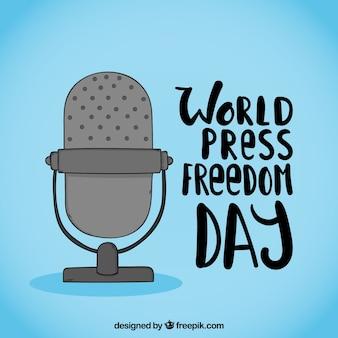 Fundo azul com microfone para o dia da liberdade de imprensa mundial