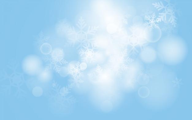 Fundo azul de flocos de neve de natal com luz abstrata bokeh