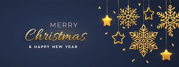 Fundo azul de natal com flocos de neve dourados e estrelas de suspensão. cartão de feliz natal.